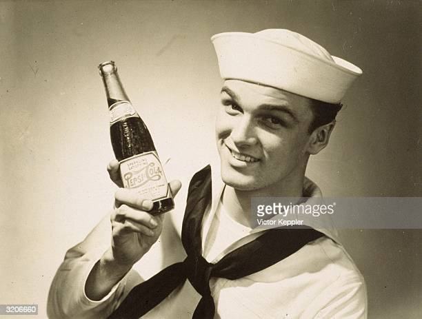 Advertisement shows a headshot of a smiling sailor holding up a full bottle of PepsiCola He wears his naval uniform