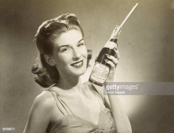 Advertisement shows a studio headshot of a woman smiling as she holds a full bottle of PepsiCola with a straw in it
