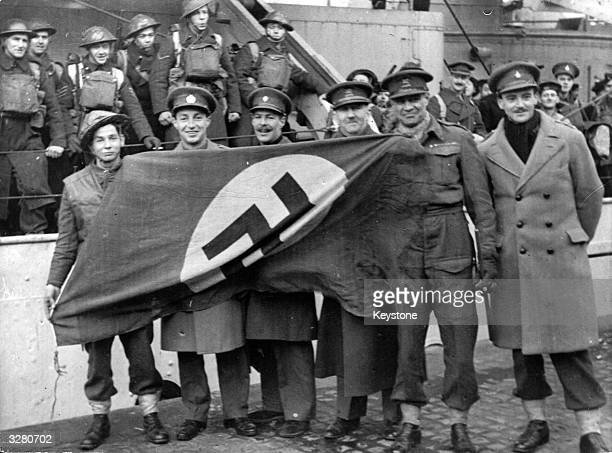 Allied troops with a Nazi flag