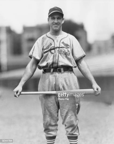 American baseball player Enos Slaughter outfielder and slugger for the St Louis Cardinals wearing his uniform while holding a baseball bat