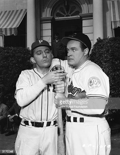 American comedian and actor Bob Hope with Bing Crosby his costar in the series of 'Road to' films Both men are part owners of baseball teams and are...