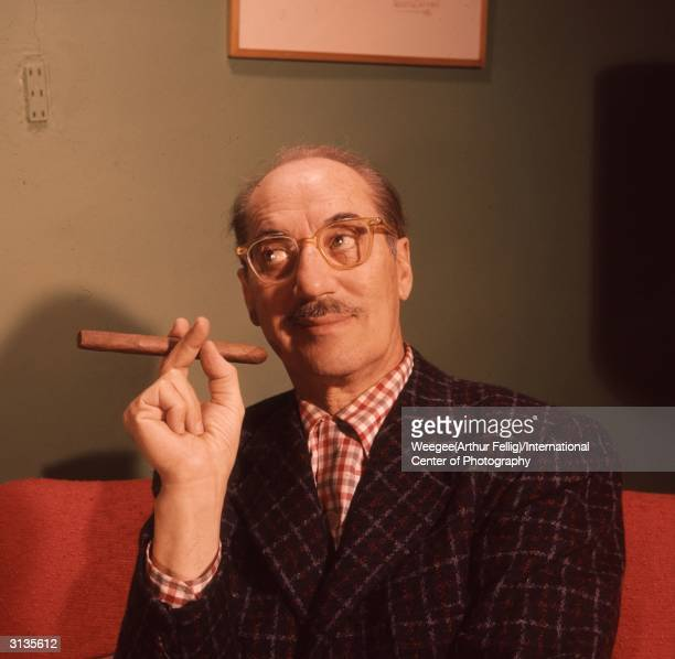 American comic Groucho Marx born Julius Henry Marx with his trademark cigar and spectacles Photo by Weegee/International Center of Photography/Getty...
