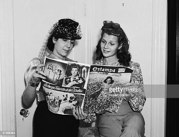 American film actress dancer and singer Rita Hayworth shares Estampa magazine with legendary Hollywood costume designer Edith Head