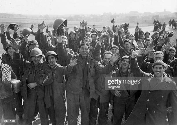 American prisoners of war celebrate their liberation from Limbourg by an American armoured division.