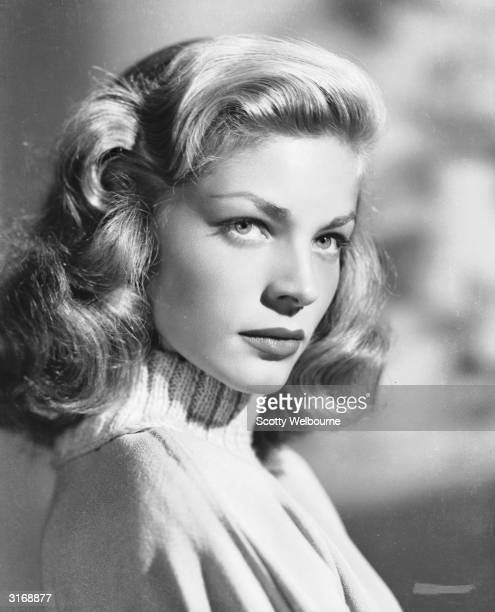 American screen star Lauren Bacall wearing a polo neck jumper