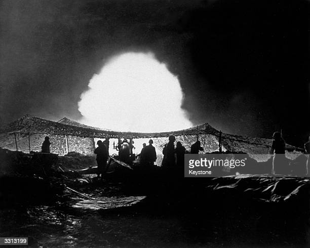 American troops at the beginning of their offensive across the Roer River early in the morning of February 23rd firing an artillery barrage