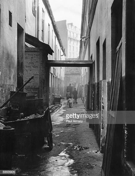 An alley in the slum district of Clichy on the outskirts of Paris