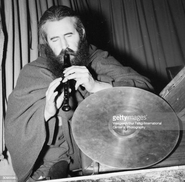 Blind American composer and street musician Moondog works from a pitch in New York's Times Square.