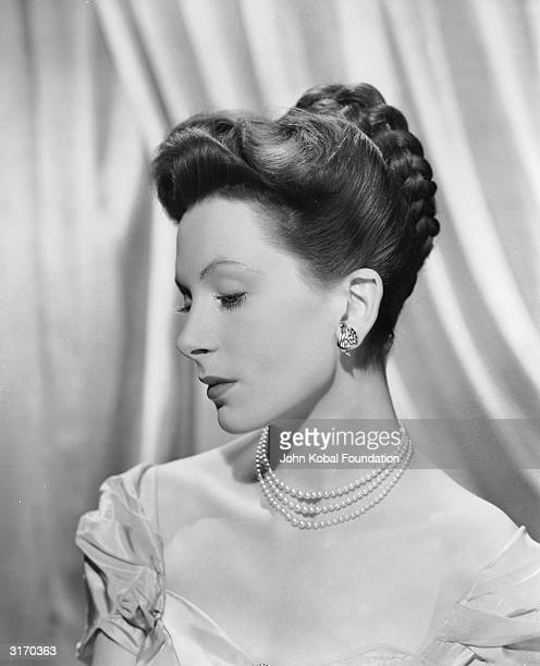 British actress Deborah Kerr wearing an evening gown and a pearl necklace