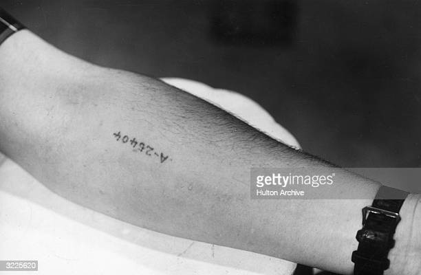 Closeup of a serial number tattooed on the inside of the arm of a former prisoner of the Auschwitz death camp in Poland World War II