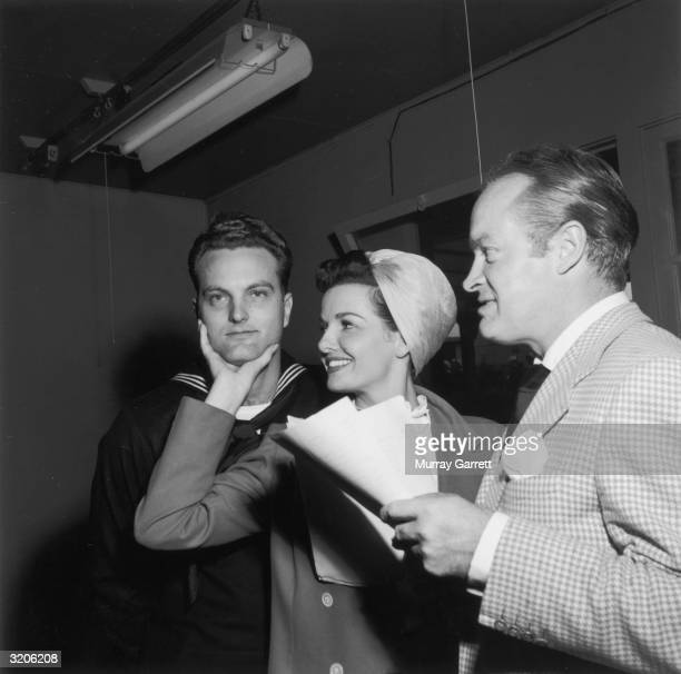 American actor Jane Russell, British-born actor Bob Hope , and an unidentified Navy officer stand backstage at Bob Hope's radio show, Los Angeles,...