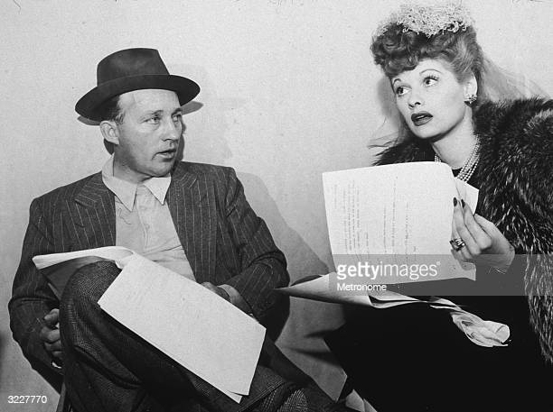 EXCLUSIVE American actors Bing Crosby and Lucille Ball sit with scripts in their laps Crosby wears a pinstriped jacket with glen plaid trousers and a...