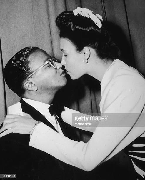 American jazz composer and musician Billy Strayhorn and American singer Lena Horne kissing.