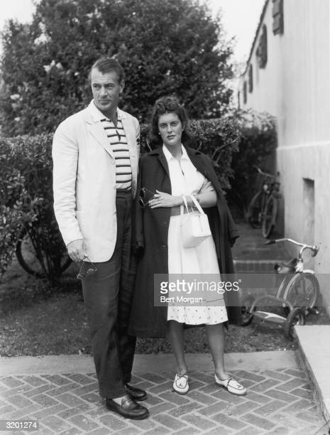 EXCLUSIVE Fulllength image of American actor Gary Cooper and his wife actor Sandra Shaw standing on a walkway at the Southampton Beach Club New York...