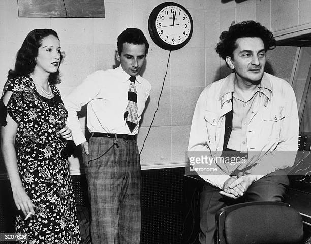 EXCLUSIVE LR Britishborn singer and actor Pat Kirkwood arranger and conductor Georgie Stoll and AR Records chief Herb Hendler listen to a playback...