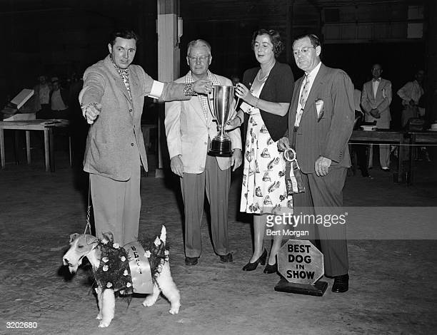 EXCLUSIVE LR Handler Peter J Patterson Palm Beach Kennel Club president Gillis R Lindeman owner Mrs Robert D Huntington and Best in Show judge Louis...