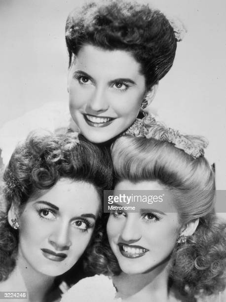 EXCLUSIVE Studio headshot portrait of American pop and jazz vocal group the Andrews Sisters Maxene LaVerne and Patty smiling