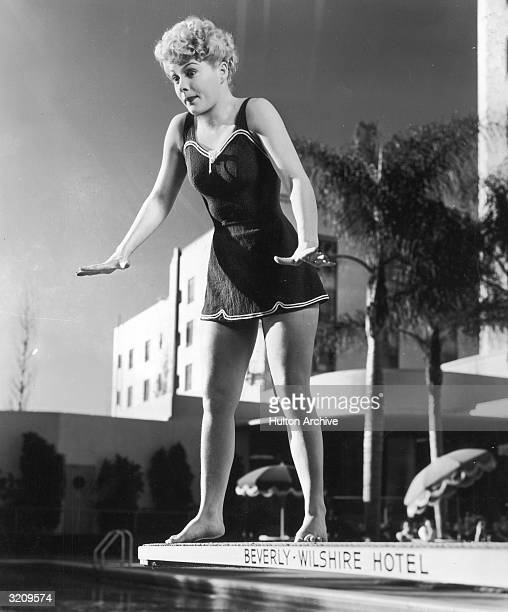 Fulllength image of American actor Betty Hutton making a face while standing on the edge of a diving board Beverly Wilshire Hotel Hollywood California
