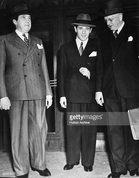 Fulllength image of American gangster Benjamin 'Bugsy' Siegel standing with two unidentified men outside a building Siegel established crime...