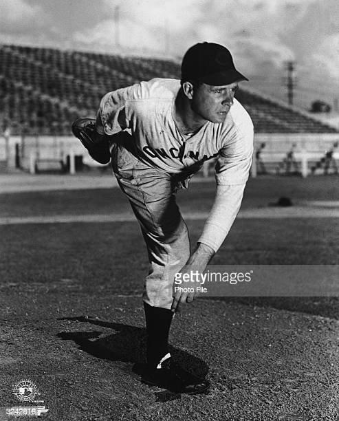 Full-length portrait of American baseball player Johnny Vander Meer , pitcher for the Cincinnati Reds, wearing his uniform and posing while holding...