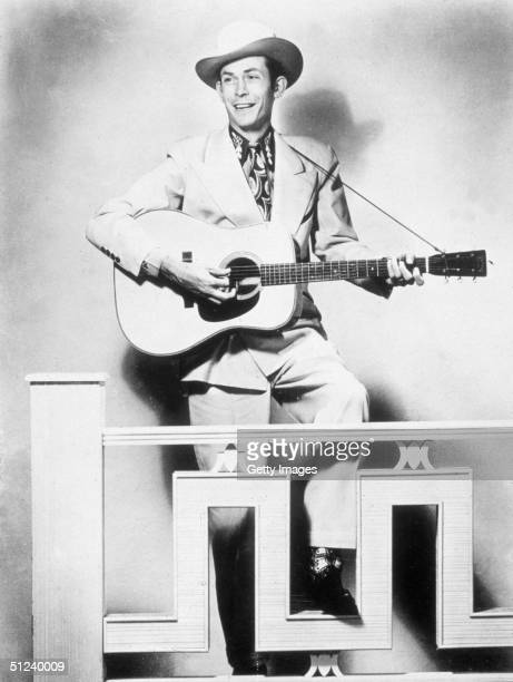 Circa 1945, Full-length portrait of American country singer and songwriter Hank Williams holding a guitar, 1940s.
