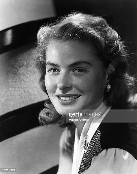 Headshot of Swedishborn actor Ingrid Bergman smiling and wearing a checkered vest in a publicity portrait from RKO Radio's 'After the Storm'