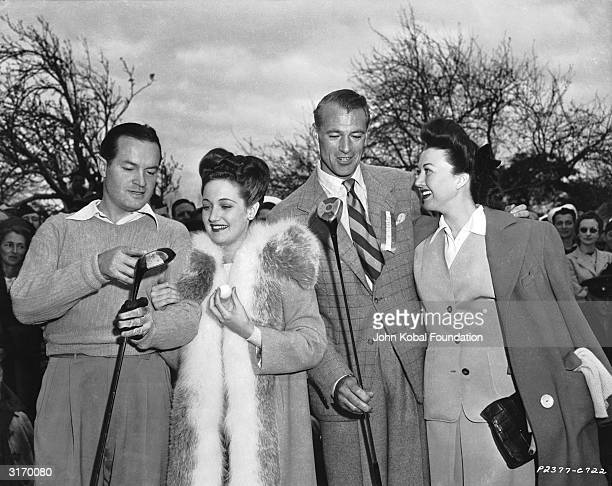 Hollywood stars, Bob Hope , Dorothy Lamour , Gary Cooper and Ginny Simms during a celebrity game of golf.