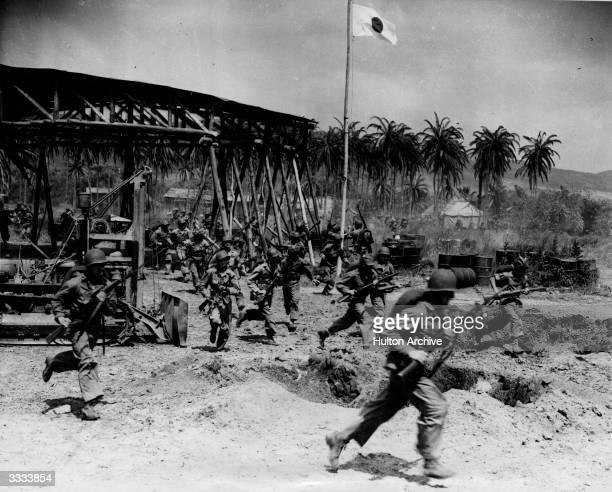 In California at Camp Pendleton 20th Century Fox re-enact scenes of the Guadalcanal landing for a film. 700 marines fully kitted out take part,...