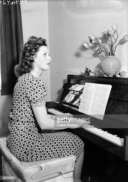 Irish actress Maureen O'Hara playing the piano