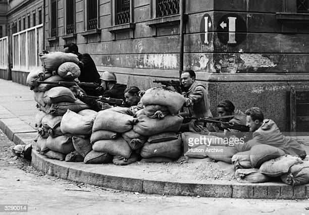 Italian Partisans in action during the liberation of Milan