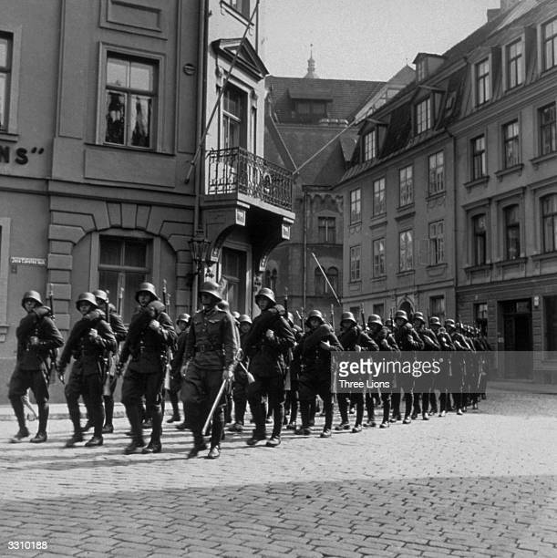 Latvian infantrymen march through a street in Riga, which was occupied by the Germans.