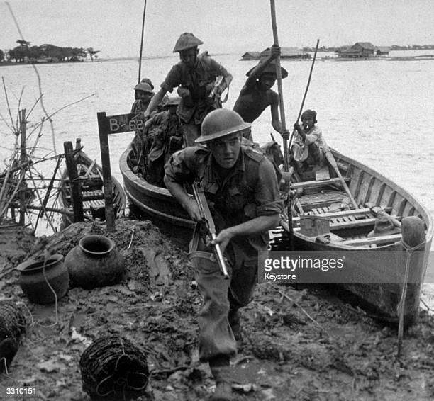 Members of the British forces in Burma prepare to search a village for Japanese soldiers