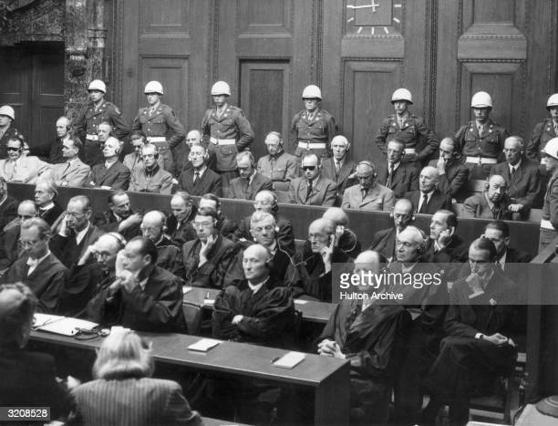 Nazi leaders sitting in a court room at the International War Crimes Tribunal Nuremberg Germany