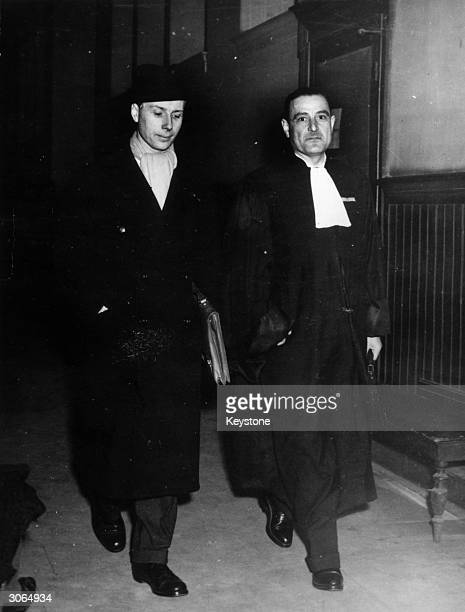 On the left Colonel Passy and his advocate waiting for the judge in the hall of the Palais de Justice Paris
