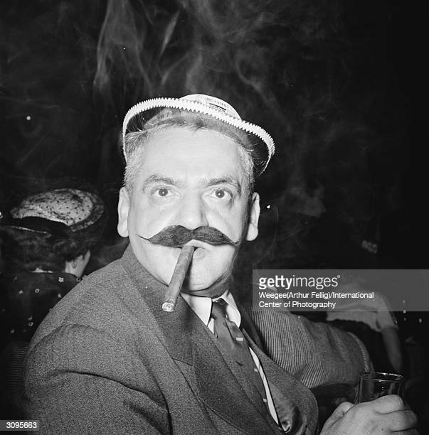 Polish born American celebrity portrait photographer Weegee disguised in a false moustache Photo by Weegee/International Center of Photography/Getty...