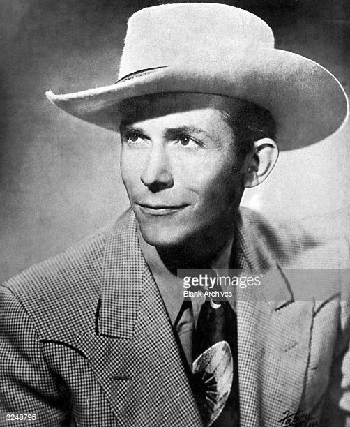 Portrait of American country singer and songwriter Hank Williams wearing a widebrimmed coyboy hat and a suit 1940s