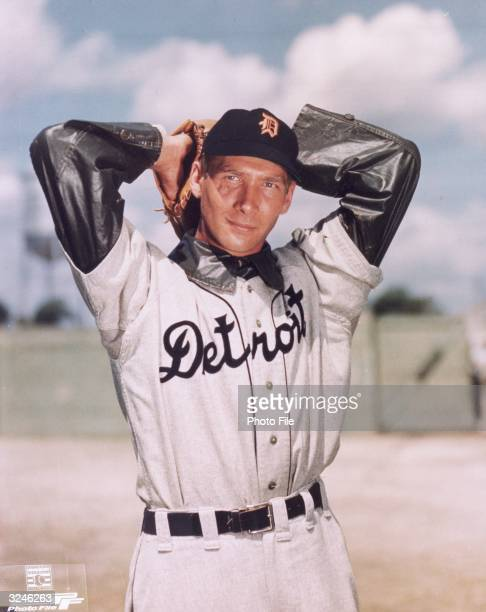 Portrait of Detroit Tigers pitcher Hal Newhouser dressed in his uniform with his hands behind his head winding up for a pitch on the mound late 1940s