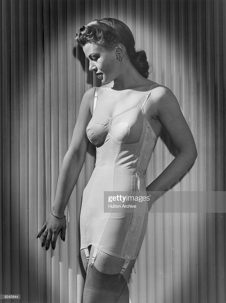 Profile portrait of a woman modeling a girdle and garter belt