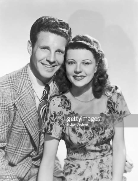 Promotional studio portrait of married American actors Ozzie Nelson and Harriet Hilliard