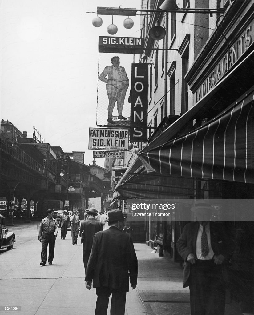 Street scene of Third Avenue, looking south from Tenth Street, with a sign for Sig. Klein's Fat Men's Shop, Manhattan, New York City.