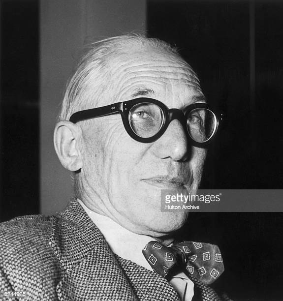 Swissborn architect and writer Le Corbusier wearing thick rimmed eyeglasses and a bow tie