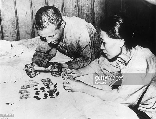 The Li family counting up their earnings from a days business running a rickshaw