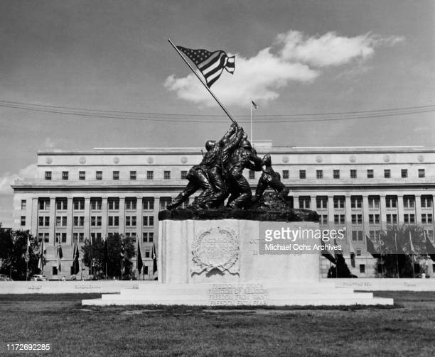 The original Marine Corps War Memorial or Iwo Jima Memorial in front of the old Navy Building in Washington, DC, depicting United States Marines...