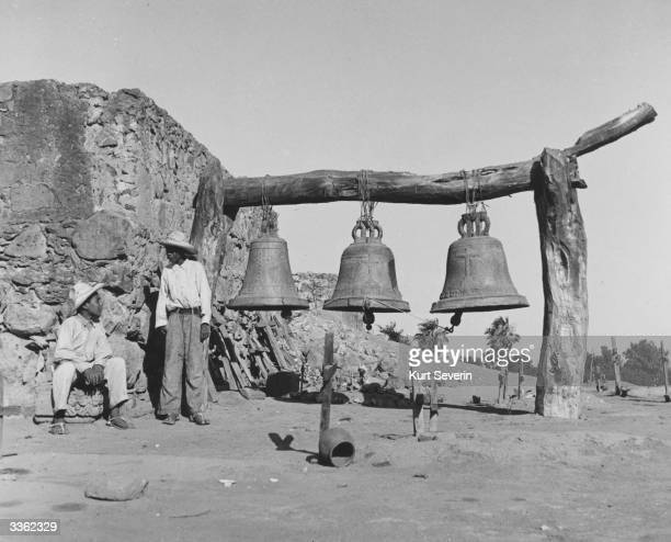 The Yaquis Indians living in the Mexican province of Sonora use these large bells not only in their graveyards but at all possible occasions...