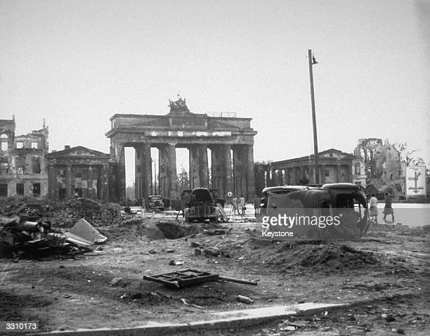 Wrecked vehicles on the Unter Den Linden near the Brandenburg Gate Berlin