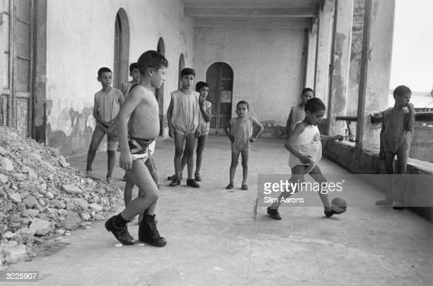 Young boys play football at a convent in Rome where they are cared for by nuns They are part of a group of children who were abandoned or orphaned...