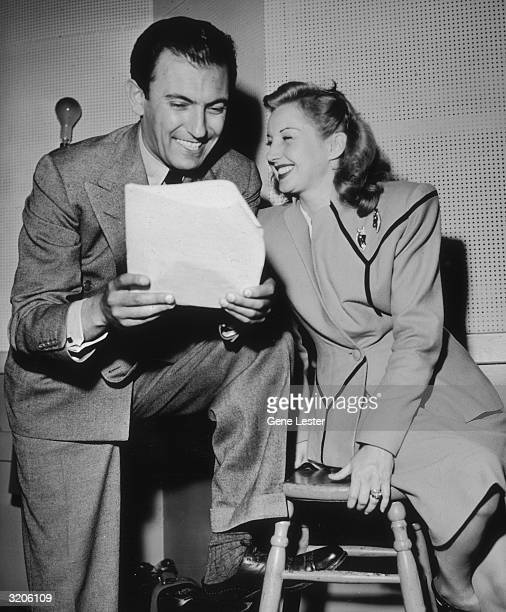 EXCLUSIVE American jazz bandleader Eddy Duchin looks over a packet of papers with American jazz singer Martha Tilton