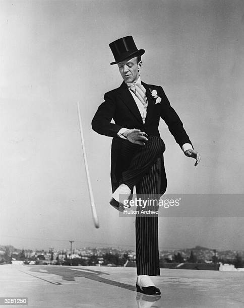 Fred Astaire , originally Frederick Austerlitz, the American dancing star, dons the familiar top hat, Ascot tie and tails for his farewell rehearsal...