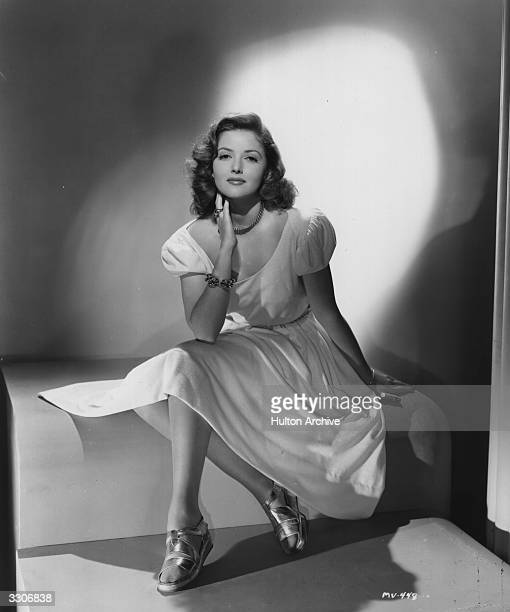 Martha Vickers the stage name of Martha MacVicar the American leading lady of the 40's She is wearing a floaty kneelength day dress with glittery...