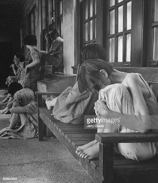 Patients sitting in the insane asylum.